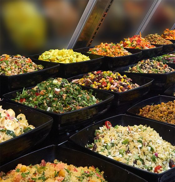 Salad bar with freshly made varieties of salad with couscous,   quinoa, salad leaves, broccoli and more