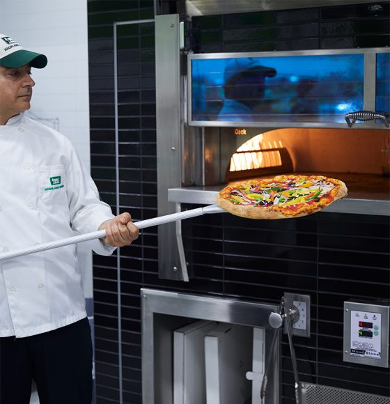 In-store Country Kitchen Chef with fire oven baked pizza