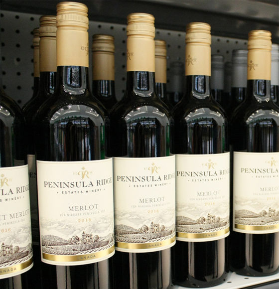 Peninsula Ridge Merlot wine bottles in Highland Farms wine department