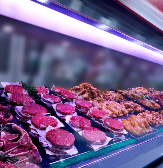Fresh ground beef, beef steaks, pork chops, pork steaks, and other meats in the meat counter