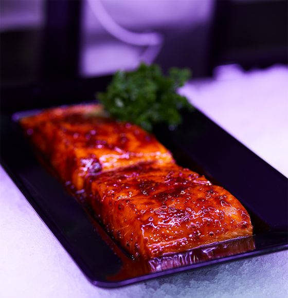 Teriyaki salmon fillets on ice in the seafood section