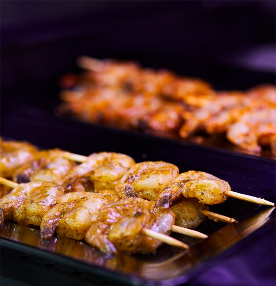 marinated shrimps on skewers  in the seafood section