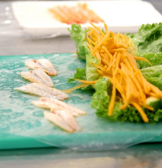Japanese salad with carrots and lettuce and sashimi in counter