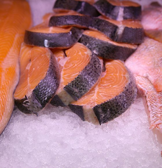 Fresh Salmon steaks and other fish on ice in the seafood section